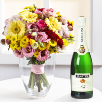 Mixed colorful bouquet and sparkling wine